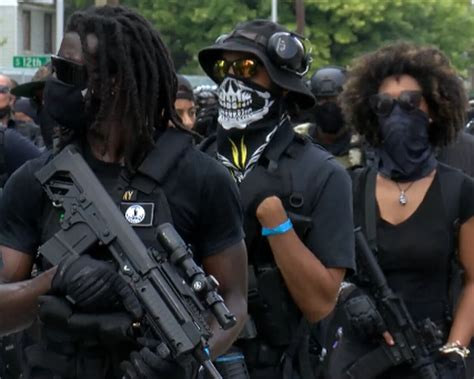 Black armed militia marched through Louisville telling