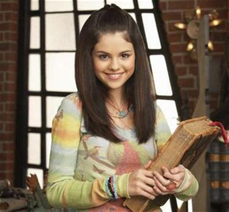 holding spell book - Wizards of Waverly Place Photo